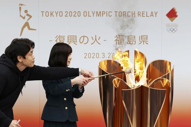 La flamme olympique est arrivée au Japon vendredi dernier (REUTERS)